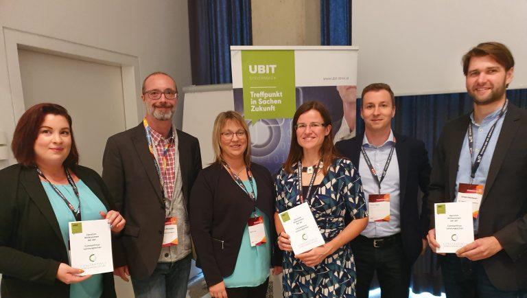 Foto von 6 Personen vor dem UBIT Rollup