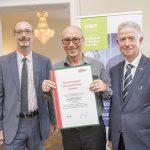 Dominic Neumann und Dr. Werner Lämmerer mit Mag. Benno Müllner